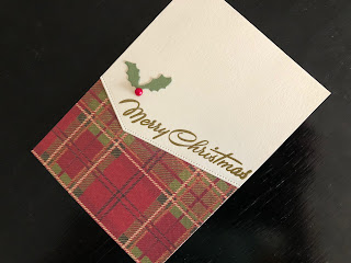 Hand made Christmas card with die cut tartan background and heat embossed greeting