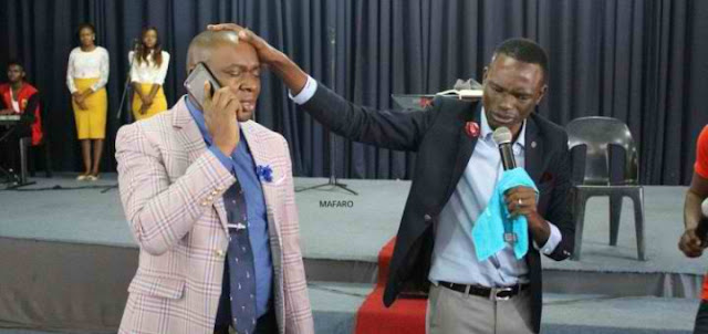 African Pastor Claims To Have God's Personal Phone Number