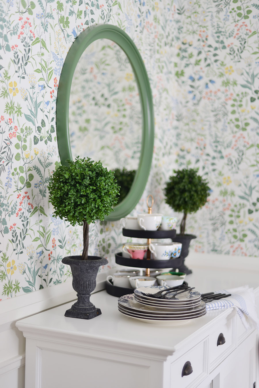 Scandianvian Borastapeter flora white wallpaper, green round mirror, buffet display, faux topiary
