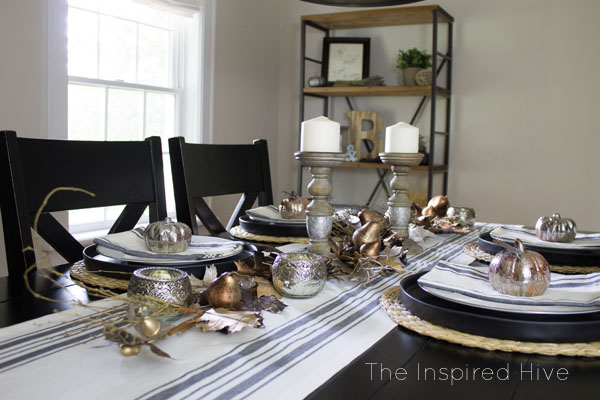 Beautiful farmhouse glam tablescape idea for fall decor and entertaining. I love the grainsack runner and the mercury glass candleholders!