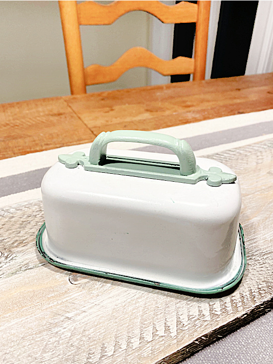 butter dish with green handle at the table