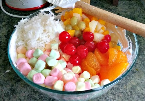 Fruity Tooty Ambrosia Salad- This quick and easy recipe makes a wonderful cool dessert for a warm day! | fruit salad, marshmallows, coconut, cherries, easy recipe, no-bake dessert
