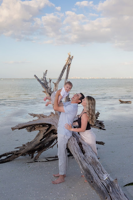 Family Photo with driftwood on Sanibel