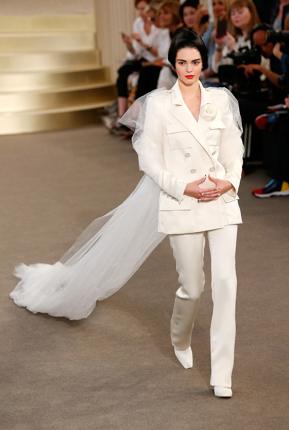 Kendall Jenner walks the Chanel Fall 2015 Paris Couture Show in a white suit and long veil