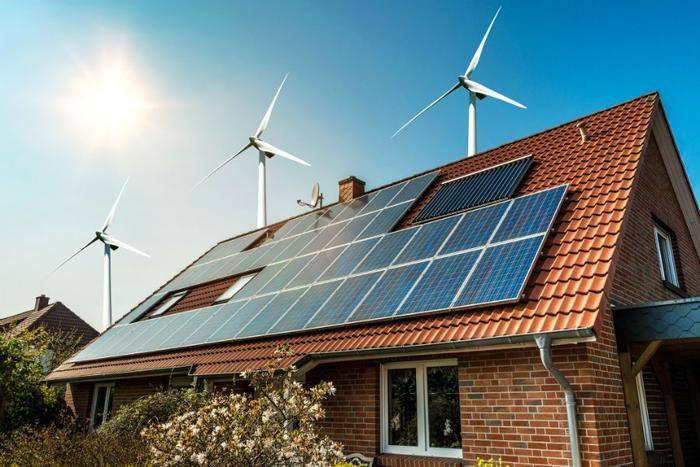 ngôi nhà lắp pin mặt trời và turbine gió
