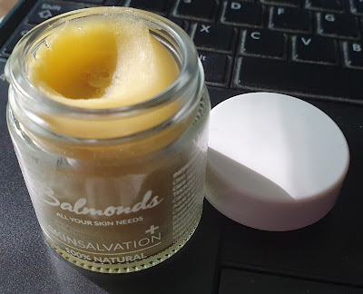 small open pot of Balmonds skin salvation 100 percent natural moisturiser showing thick consistency