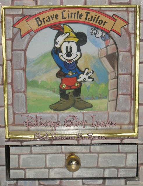 This is a highly unusual Disney trinket box featuring Mickey Mouse as the Brave Little Tailor.