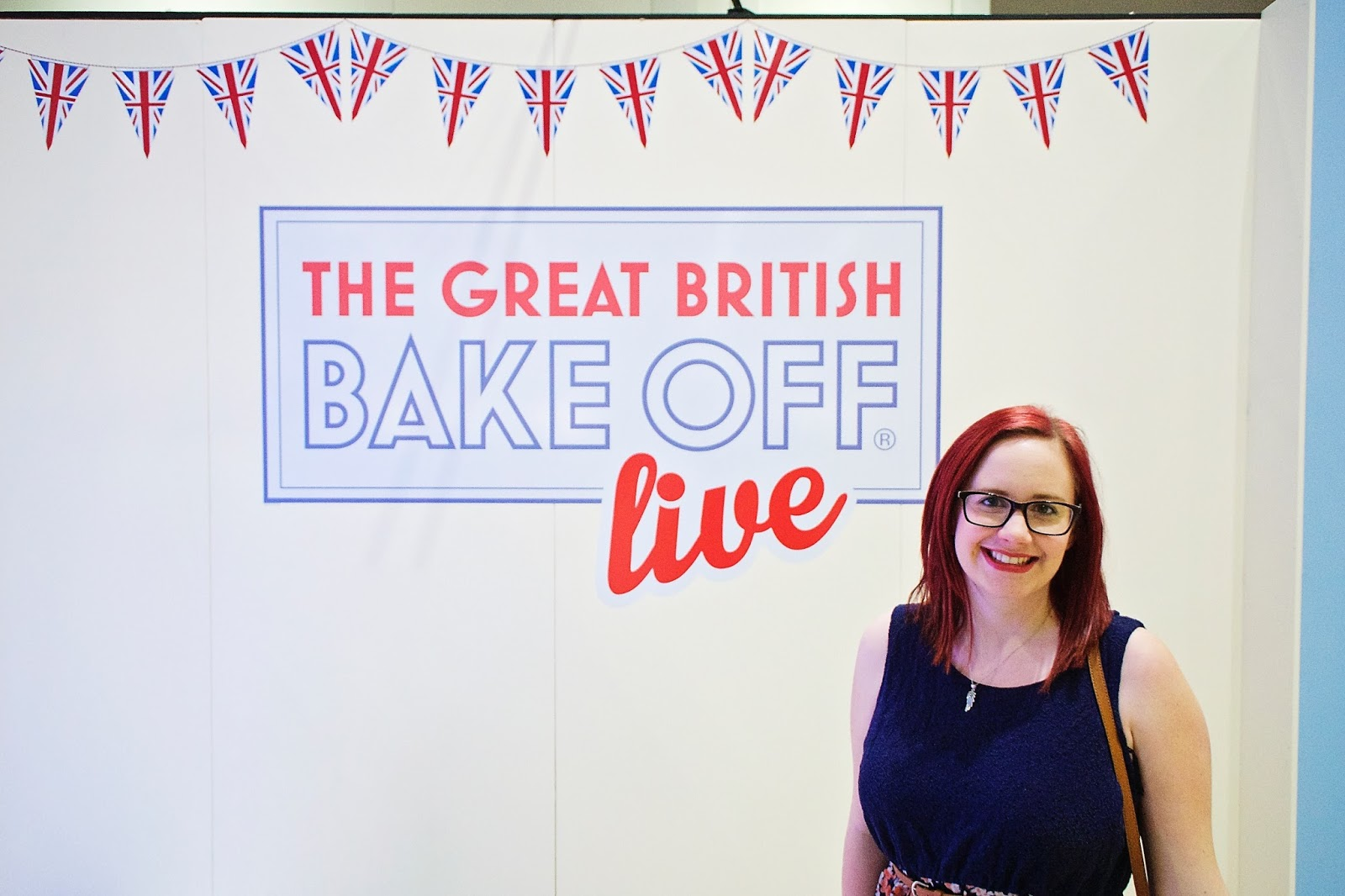 Me standing in front of the Great British Bake Off Live sign