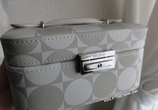 Carpisa jewelry case with taupe and white circle print