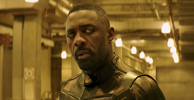 Movie still for the 2019 film Hobbs & Shaw where Idris Elba shows off his cybernetic enhancements as the villain of the story
