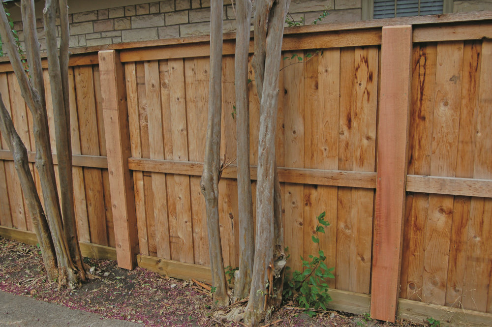 The Fence Line Building A Wood With Metal Posts