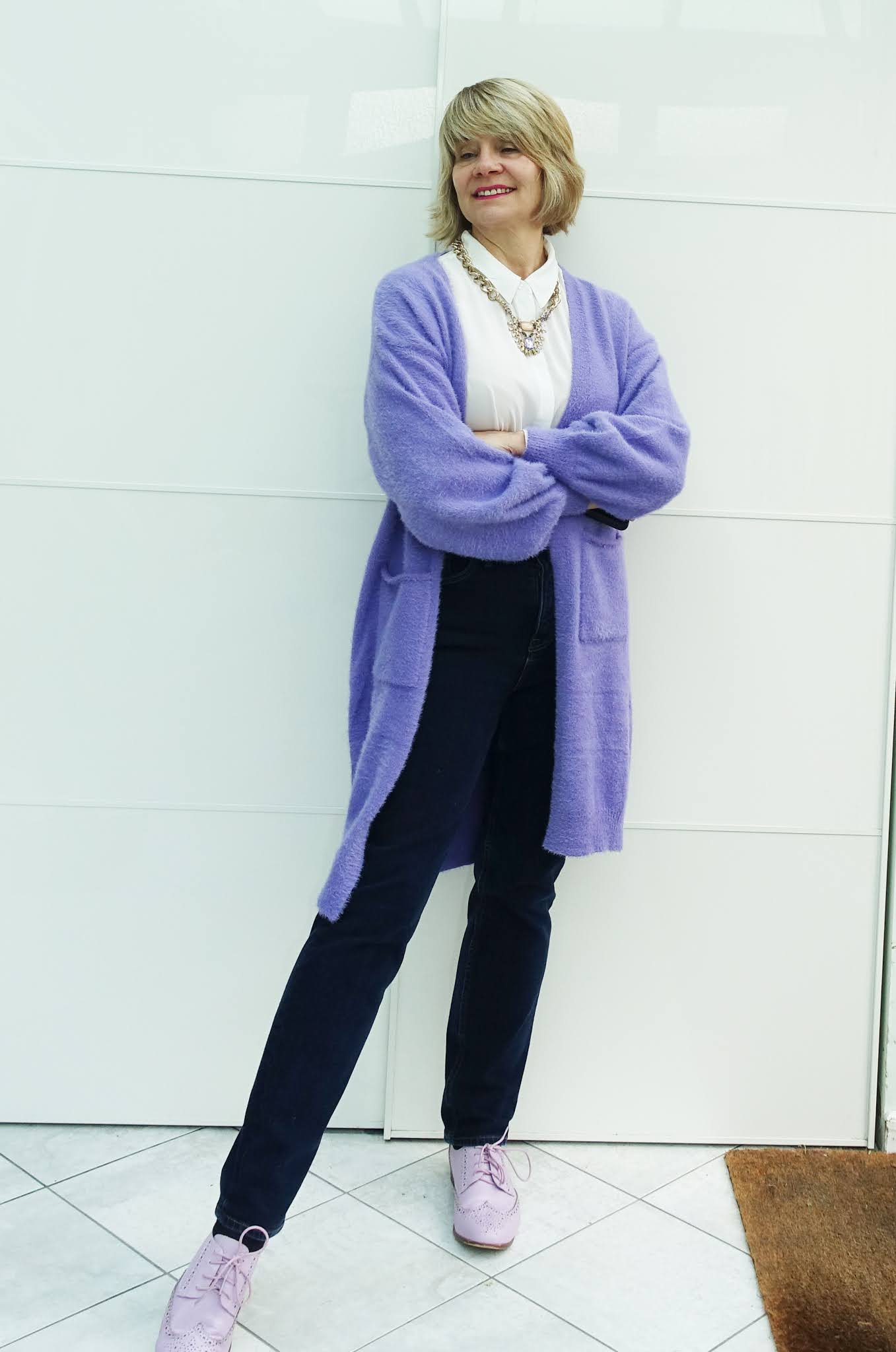 A long lilac cardigan with matching brogue shoes and jeans