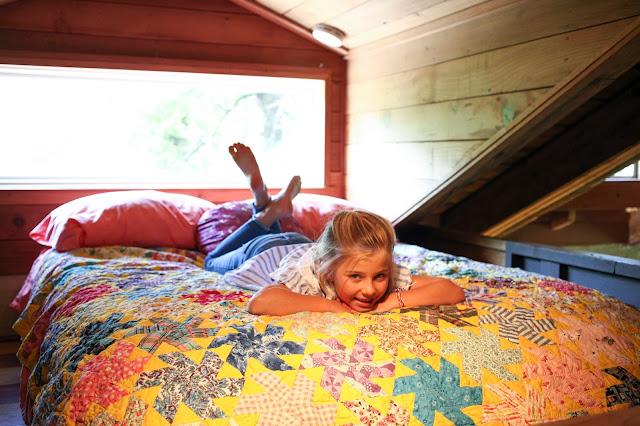 Little girl relaxing in a loft