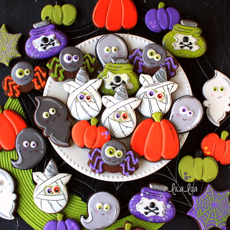 Halloween decorated chocolate sugar cookies -- spiders, ghosts, pumpkins, mummy unicorns and potion bottles