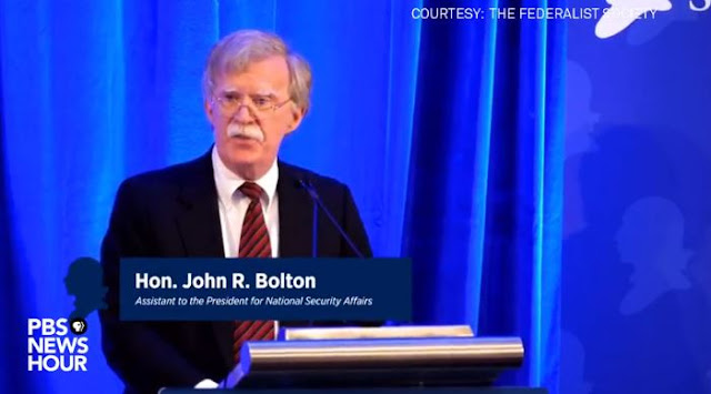Image Attribute: National Security Adviser John Bolton speaks at a Federalist Society luncheon at the Mayflower Hotel on September 10 in Washington. / Source: YouTube screengrab