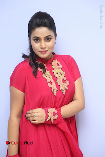 Actress Poorna Latest Stills in Red Dress at Rakshasi First Look Launch  0125.JPG