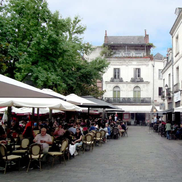 Place Plumereau, Tours.  Indre et Loire, France. Photographed by Susan Walter. Tour the Loire Valley with a classic car and a private guide.