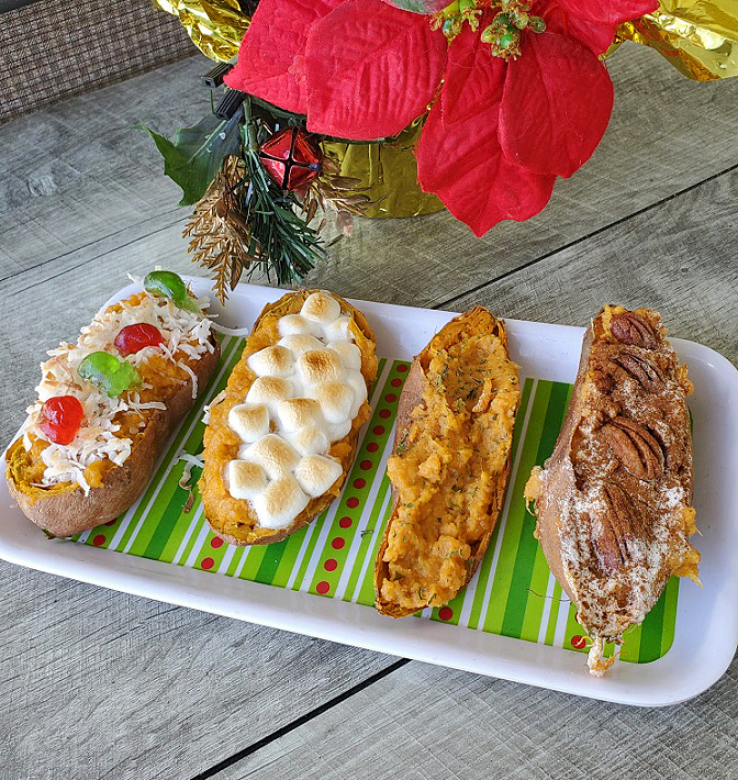 these are sweet potatoes stuffed on a wooden board and poinsettia plant in the background
