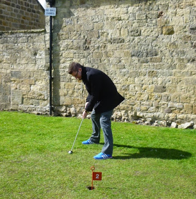 Playing the Putting Green at Knaresborough's Castle Yard
