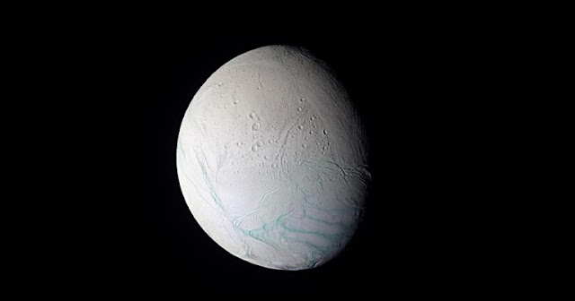 "Saturn's tiny, frozen moon Enceladus is slashed by four straight, parallel fissures or ""tiger stripes"" from which water erupts. These features are unlike anything else in the solar system. Scientists at UC Davis, the Carnegie Institution and UC Berkeley now have an explanation for them. (NASA/JPL/Space Science Institute image)."