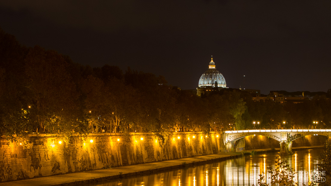 A view of Vatican City at night from the River Tiber in Rome