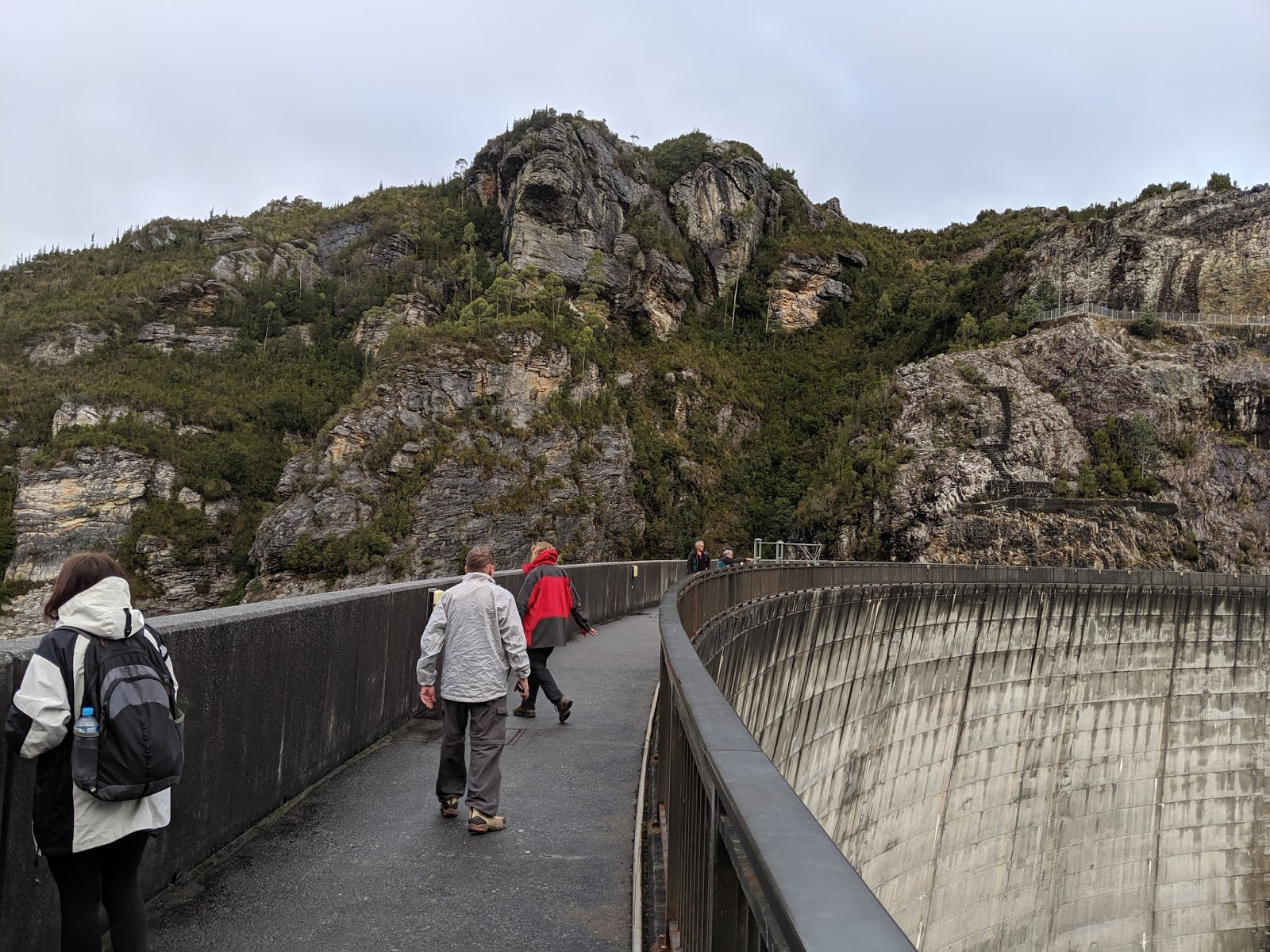 hight resolution of  walk down to the dam wall and staring down to where a quiet trickle of water now follows the course of the original gordon river downstream of the dam
