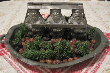 A pewter Santa Candy Mold