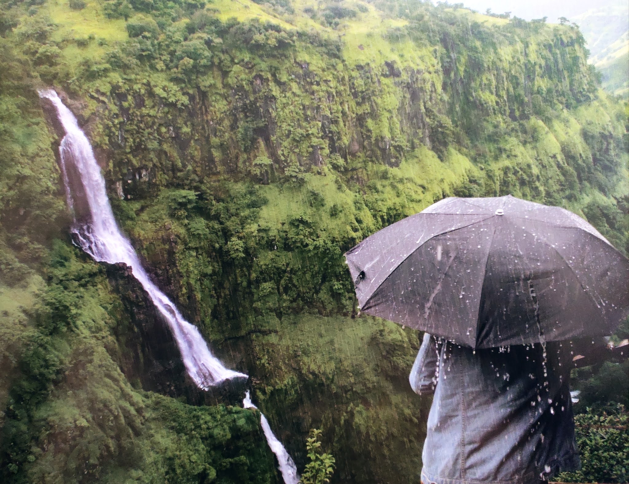 Image contains a water fall in rainy season