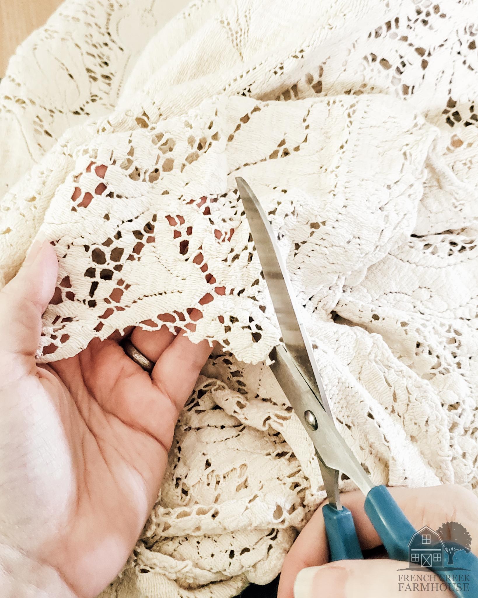 Cut pieces of antique lace for appliques