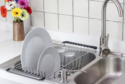 dish rack that rests over the sides of the sink, with the rack dipping down into the sink