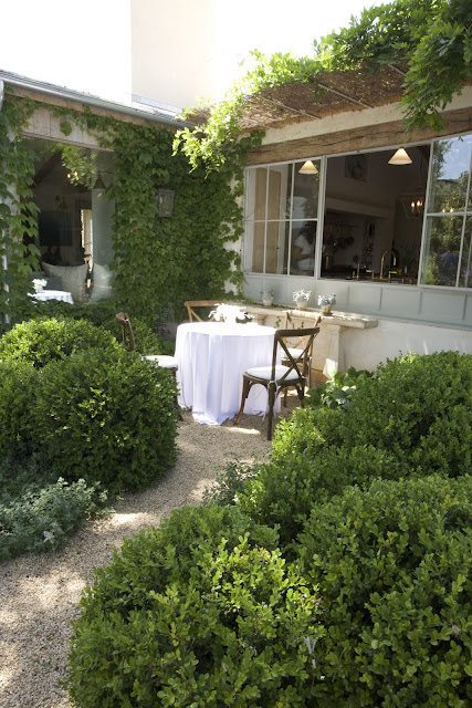 Garden with chairs and table next to kitchen