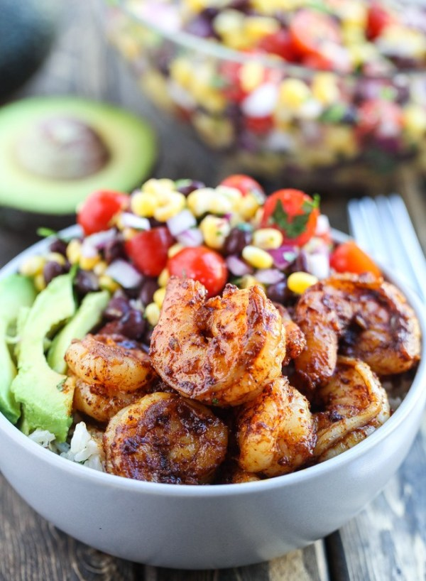 Spicy Shrimp Burrito Bowls - Spicy Shrimp Burrito Bowls recipe with cilantro lime rice and a corn black bean salsa. They are so good and make the perfect weeknight meal!