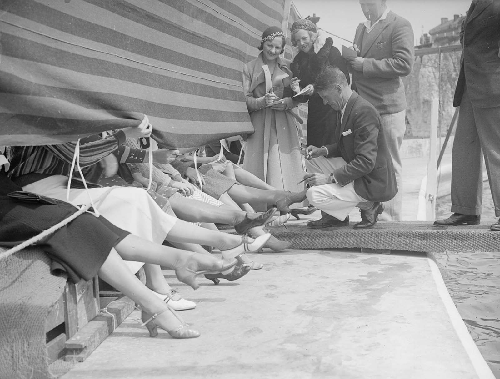 Judges and competitors at a 'prettiest ankle' contest, Cliftonville, Kent in 1933.