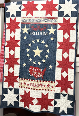 red and white stars around a patriotic panel