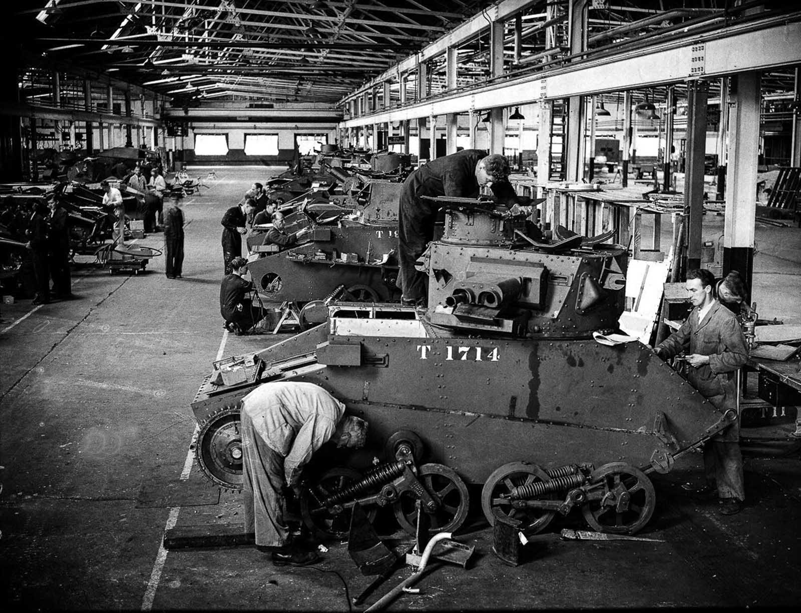 British tanks on an assembly line. Some of the tanks are being repaired following the evacuation of Dunkirk. 1940.