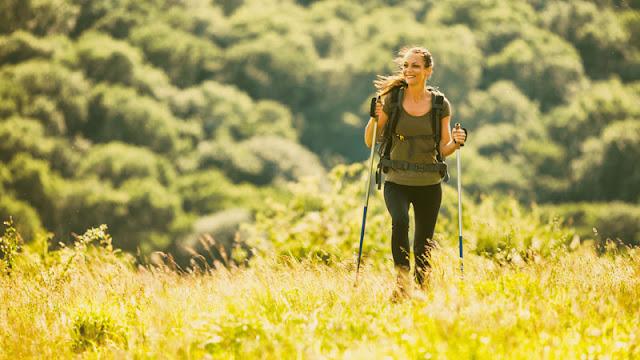 Woman Hiking in Meadow