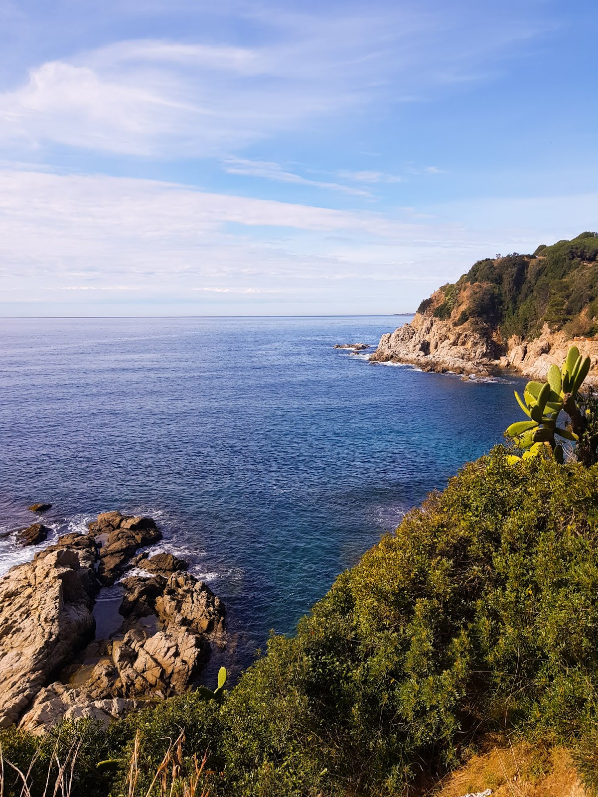 Photo on Thelifeofaglasgowgirl overlooking the ocean and some rock from a high point in Lloret de mar. Beautiful blue ocean with white waves crashing upon the rocks.