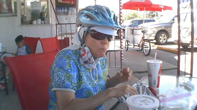 Sneaky husband got a photo of JoLynn enjoying the Grilled Hot Dog and Ice Tea, ;)