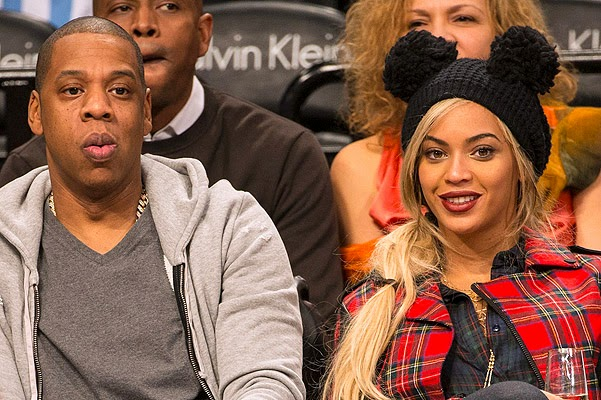Beyonce Mickey Mouse Jay-Z at a basketball game