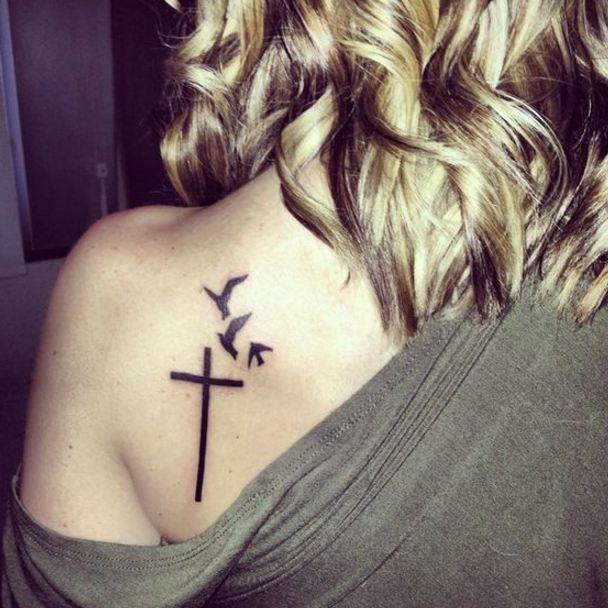 spine cross tattoos