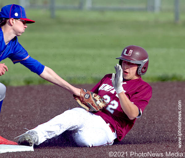 Damian Knoll slides into second on steal