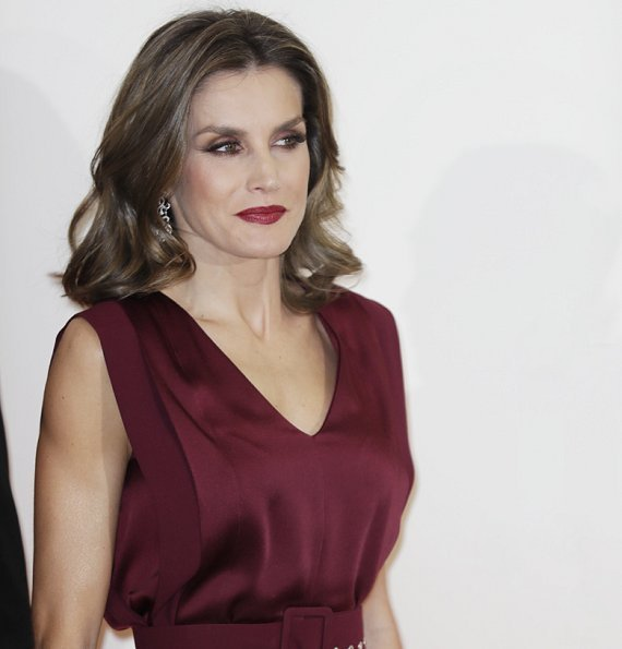 Queen Letizia wore Carılina Herrera Jumpsuit, Carolina Herrera Print-Clutch Bag, Carolina Herrera Suede pumps