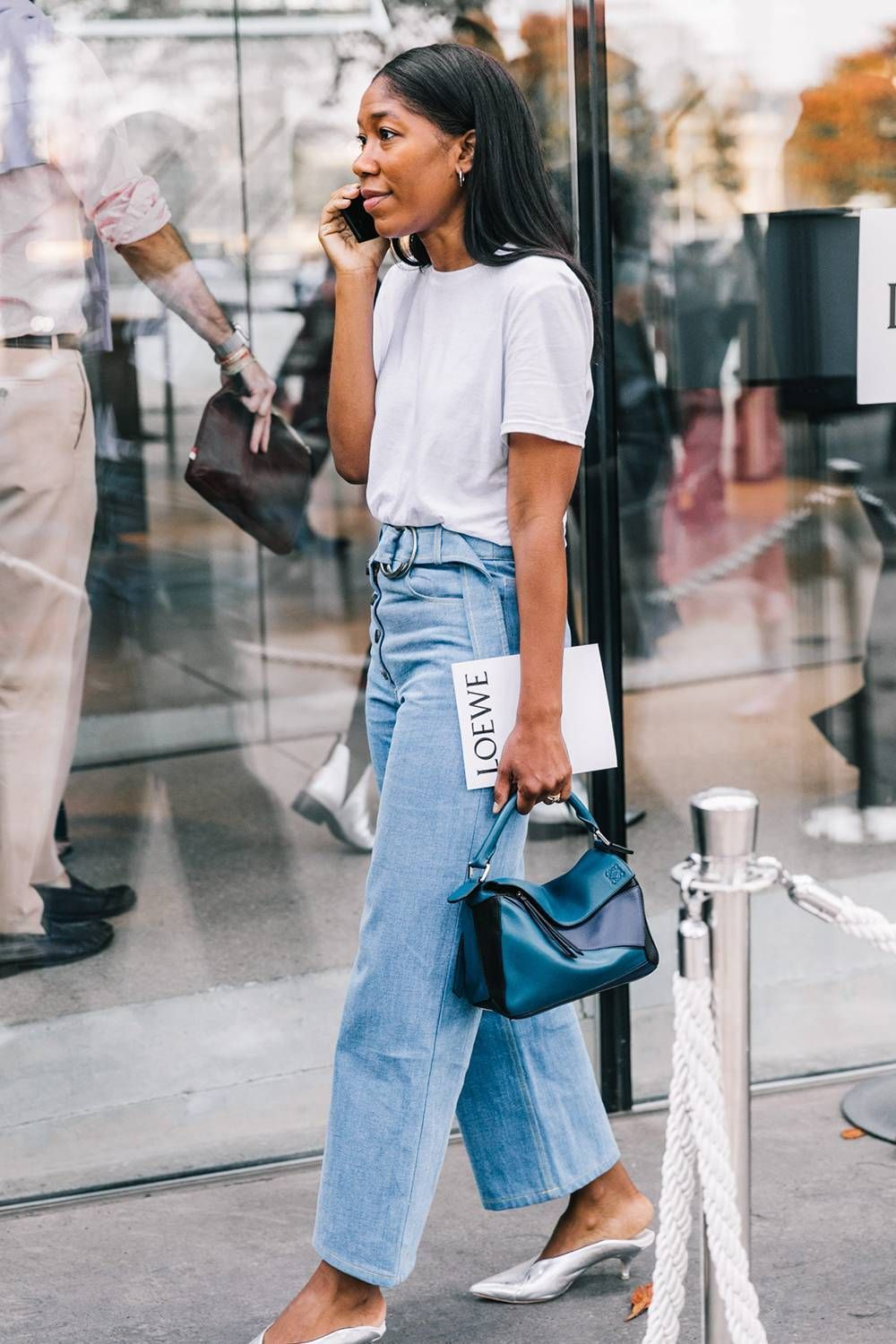 easy stylish spring look summer outfit idea — collage vintage street style with a white t-shirt, belted jeans, silver mules