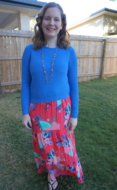 cobalt blue knit cropped jumper worn over coral floral print maxi dress winter birthday party layered outfit | awayfromblue