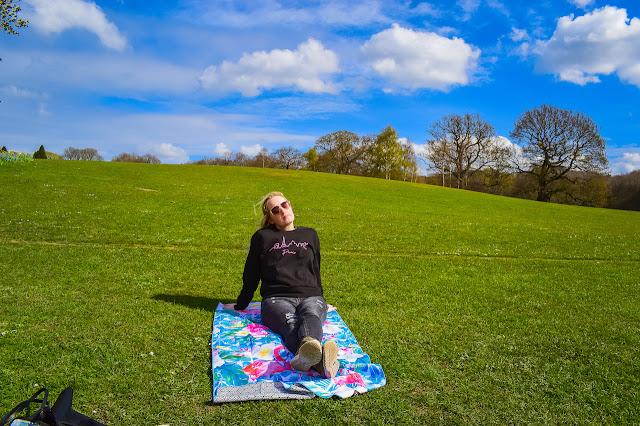 Tesalate towel - sitting on towel in park