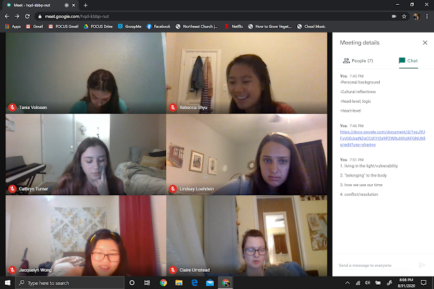 Here is a photo of us working through a question-writing activity as each of the girls is simultaneously on this Google Meet video call AND talking on the phone to their co-leader.