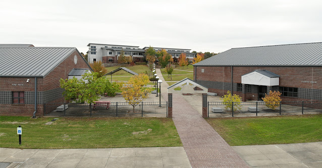 Image of campus buildings including the Student Union, Fine Arts Building, and the University Center