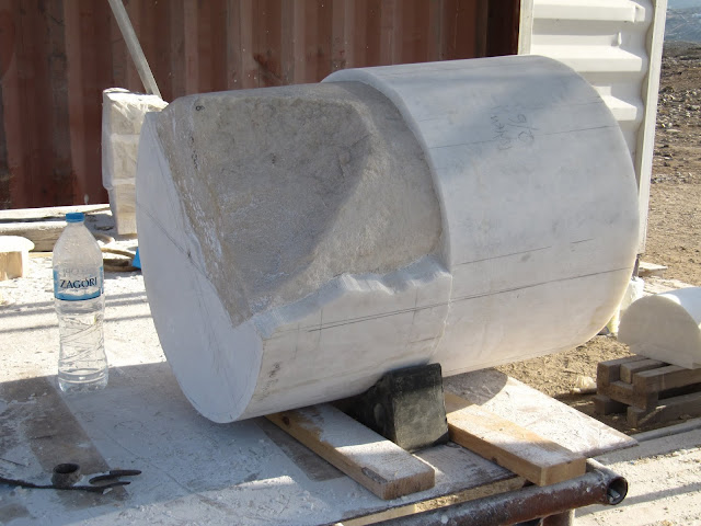 New-meets-old marble column base ready for shaping