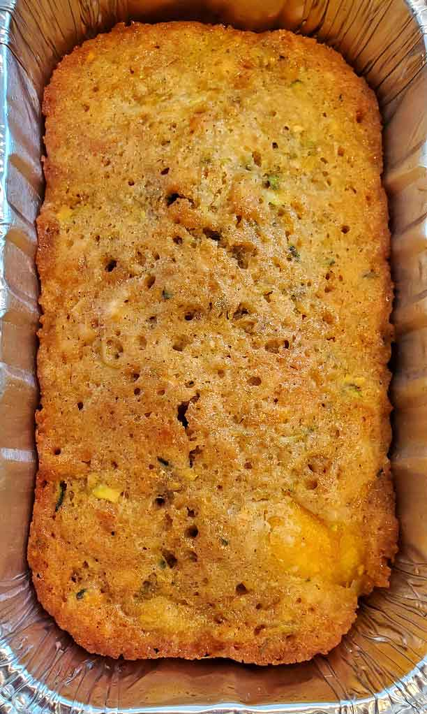mango zucchini in a loaf pan cooling