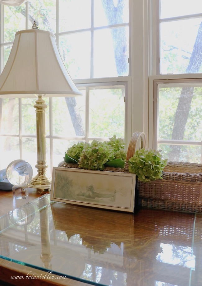 Summer fades into fall with ideas for home decor with a wicker basket nestled behind a glass desk pad